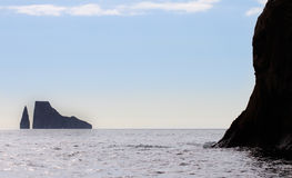 Kicker Rock. Kick Rock sits on the horizon on a clear, sunny day Royalty Free Stock Photo