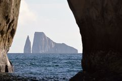 Kicker Rock in Galapagos. Kicker Rock in the Galapagos Islands, Ecuador is framed by a rock arch. Photo taken June 2014 Stock Images