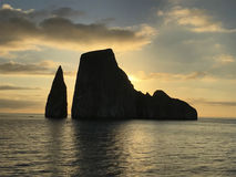 Kicker Rock at Sunset. Kicker Rock at San Cristobal Island in the Galapagos Archipelago. The two rocks are 140 meters tall and an excellent dive site Stock Image