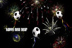 Kickin' In The New Year. Soccer balloons and fireworks in a black sky Royalty Free Stock Photography