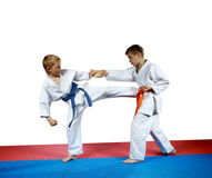 Kicking against blow hand is performing sportsman with a blue belt Royalty Free Stock Image