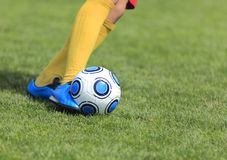 Kicking the ball Royalty Free Stock Photography
