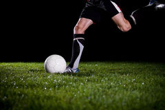 Kicking the ball Stock Images