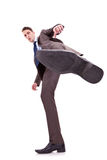 Kicking business man Stock Photo