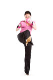 Kicking businesswoman with boxing gloves Stock Photo