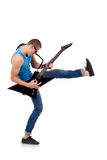 Kicking guitarist Royalty Free Stock Photo