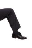 Kicking leg. Isolated on white - Business metaphor royalty free stock photo