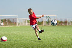 Kicking soccer ball Stock Photography