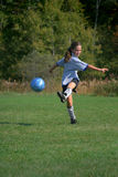 Kicking a soccer ball Stock Photo