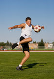 Kicking a soccer ball Royalty Free Stock Images