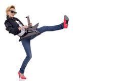 Kicking woman guitarist Royalty Free Stock Images