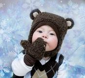 Kid. The little boy in a suit of a bear cub in New Year's conditions Stock Photo