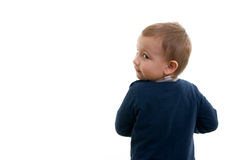 Kid. The boy is hiding something Royalty Free Stock Photos