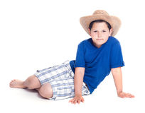 Kid. A young guy in a hat on a white background Stock Images