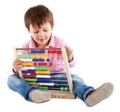 Kid with an abacus Stock Photography