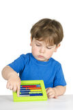 Kid with an abacus. Royalty Free Stock Images