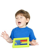 Kid with an abacus. Royalty Free Stock Image