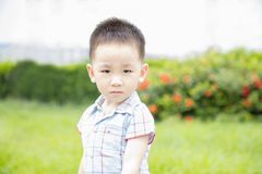 Kid absorbed in front outdoor Stock Photo