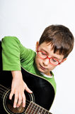Kid with acoustic guitar Royalty Free Stock Photography