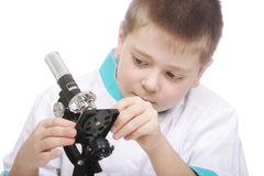 Kid adjusting microscope Stock Photography