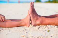 Kid and adult feet on white sandy beach Royalty Free Stock Photos