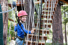 Kid at adventure park Stock Photos