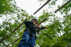 Kid in adventure park. Boy in an adventure park  going through a tour Stock Image