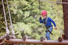 Kid in adventure park royalty free stock image
