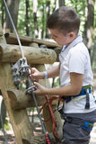 Kid in adventure park. A kid in Edenland adventure park. Edenland is an adventure park located in Balotesti village, 20 km away from Bucharest, Romania Stock Photos