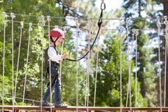 Kid at adventure park. Little boy enjoying climbing at adventure park Royalty Free Stock Photos