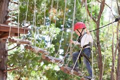 Kid in adventure park. Little kid climbing at adventure park Royalty Free Stock Photography