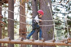 Kid in adventure park. Little kid climbing at adventure park Royalty Free Stock Images