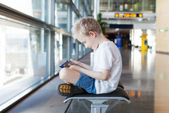 Kid at airport Stock Photography