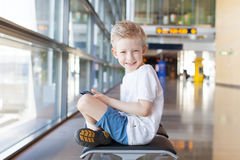 Kid in airport Royalty Free Stock Images