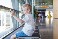 Kid in airport Stock Photos