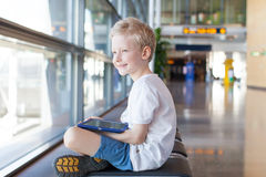 Kid at airport Stock Photo