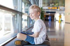 Kid at airport Stock Photo