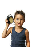 Kid with alarm clock Royalty Free Stock Photography