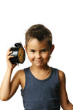 Kid with alarm clock Royalty Free Stock Photos
