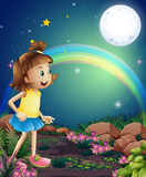 A kid amazed by the sight of the rainbow and the fullmoon Royalty Free Stock Image