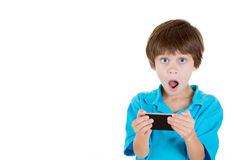 A kid amazed at what he sees on cellphone Royalty Free Stock Photo