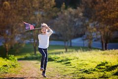 Kid with american flag stock photos