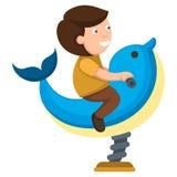 Kid on amusement dolphin Stock Image