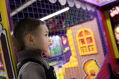 Kid in amusement park Stock Image