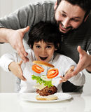 Kid And Father Making Burger Stock Photo
