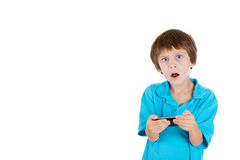 A kid annoyed at something that he sees on his phone Stock Photography