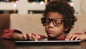 Kid appears at computer desk. Smart boy typing text. Surprise appearance of young thinker. Ideas for Christmas letter stock footage