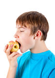 Kid with the Apple. Teenager eat an Apple Isolated on the White Background Stock Photos