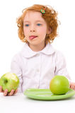 Kid with apples Royalty Free Stock Images