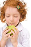 Kid with apples Stock Images